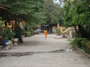 Monk walking through temples in Savannakhet