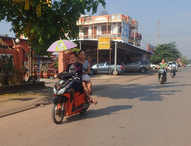 Laos women staying out of the sun