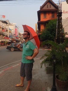 Walking around Laos with an umbrella