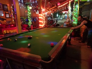 Playing pool in a Christmas-themed bar in Vang Vieng